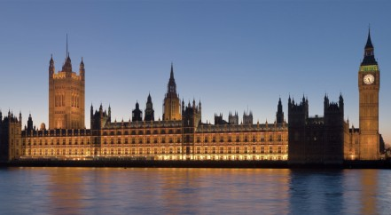 Houses of parliament across the Thames in the evening,
