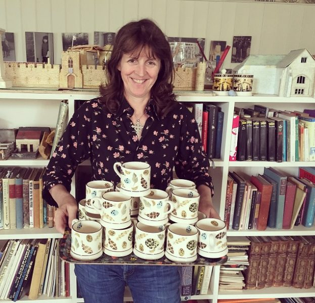 Emma Bridgewater holding the bespoke mugs she designed for Pancreatic Cancer Action
