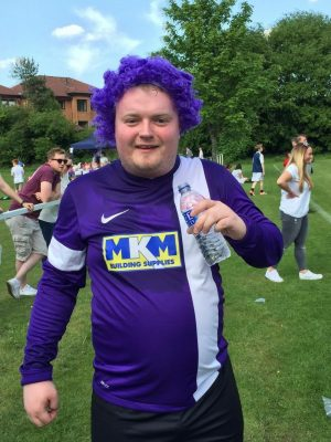 Andrew Clark with purple wig