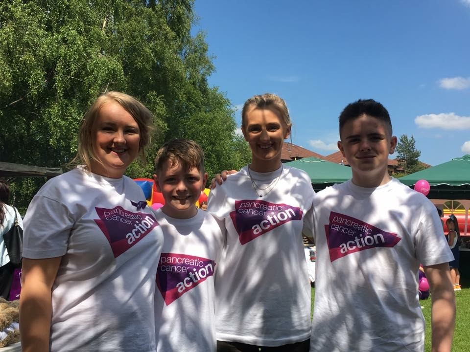 group of 4 in Pancreatic Cancer Action tshirts on