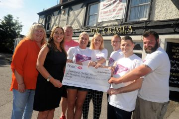 The Crimea Inn, Aldershot. Cheque pres to Lucy de'Lemos from Pancreatic Cancer Action (front left) from jumpers Tracy Parker, Samantha Gordon, Andy Fyfe, Connor Field, Colin Wilson and landlords Jan and Ray Hedgeman following a charity bungee jump event.