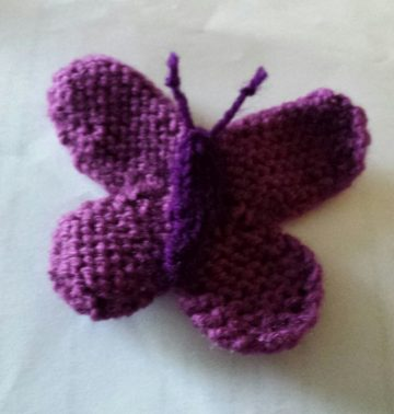 knitting purple butterfly
