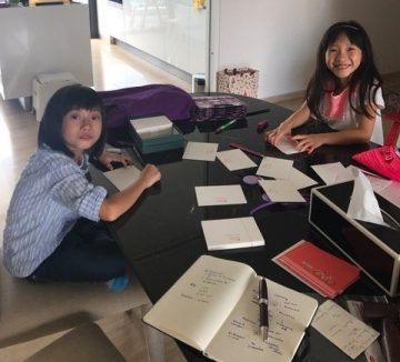 audrey and kendra writing thank you cards - Copy