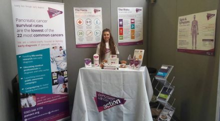 Issy holding an awareness stand at the 50+ show in London Olympia