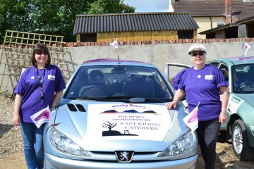 A photo of Wacky Racer's Celia and Sue with their car, raising funds for Pancreatic Cancer Action