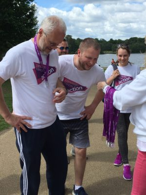 A photo of two Striders receiving their medals at Striding for Survival in Virginia Water 2017