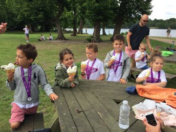 A group of young Striders enjoying ice-cream after Striding for Survival in Virginia Water 2017