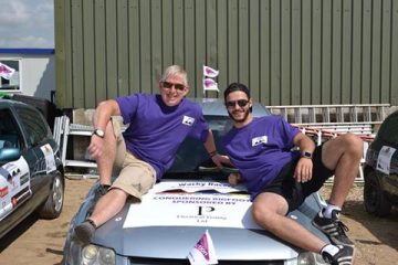 A photo of Wacky Racer's Darren and Timmy with their car, raising funds for Pancreatic Cancer Action
