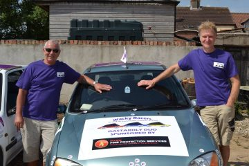 A photo of Wacky Racer's Steve and James with their car, raising funds for Pancreatic Cancer Action