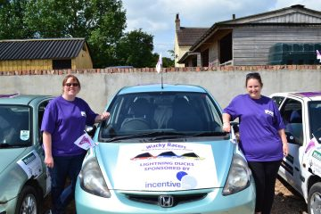 A photo of Wacky Racer's Nikki and Emily with their car, raising funds for Pancreatic Cancer Action