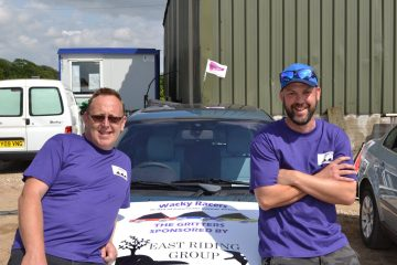 A photo of Wacky Racer's Simon and David with their car, raising funds for Pancreatic Cancer Action