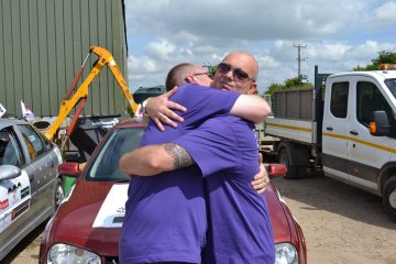 A photo of Wacky Racer's Paul and Malcom with their car, raising funds for Pancreatic Cancer Action