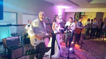 A photo of the Smith family, who are raising funds for Pancreatic Cancer Action, playing on their wedding day.