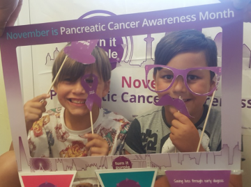 Two entrants in the Turn it Purple competition to become the cover photo of Turn it Purple social media during Pancreatic Cancer Awareness Month