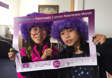 Audrey & Kendra using our new Turn It Purple selfie frame for Pancreatic Cancer Awareness Month
