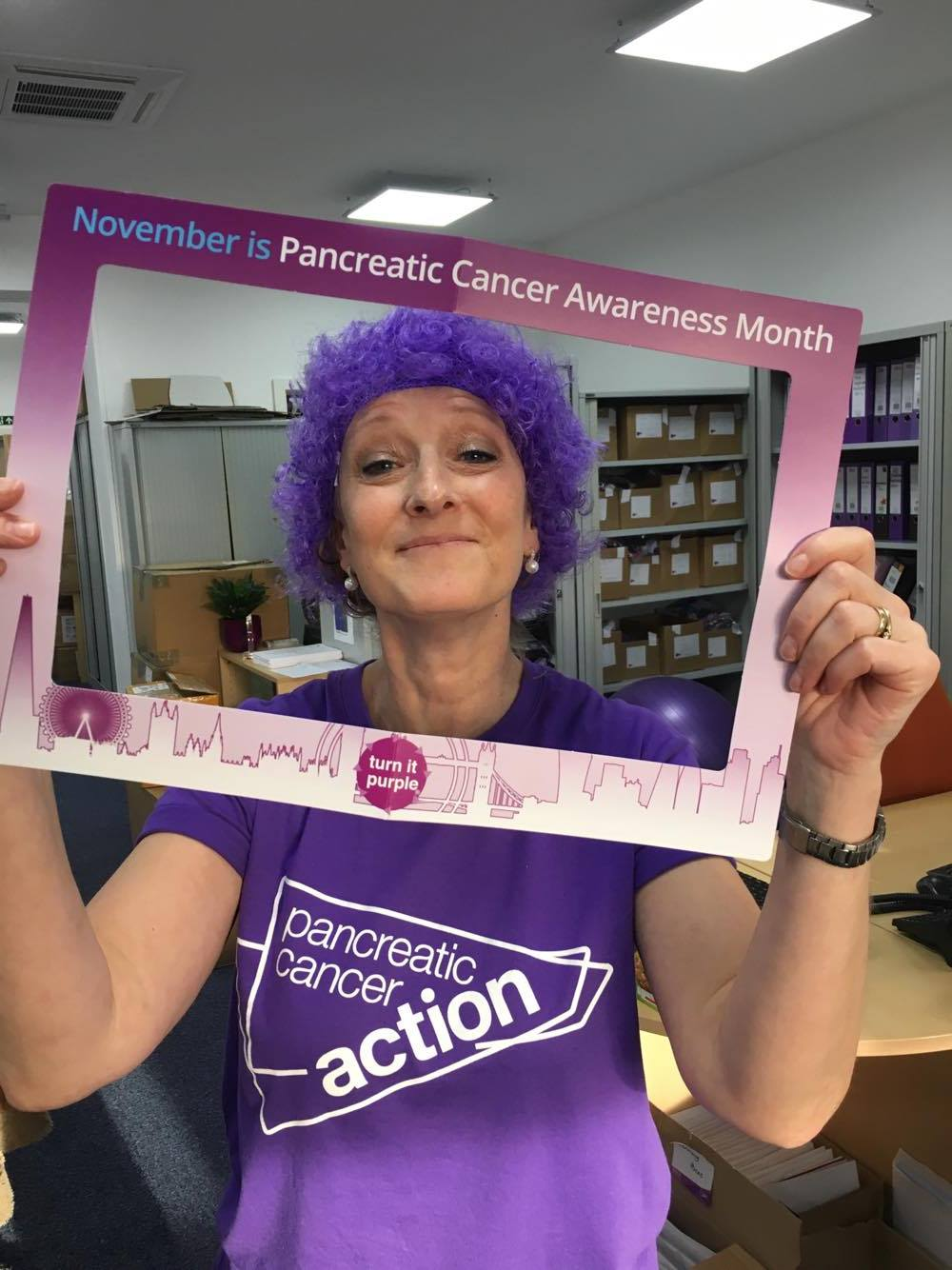 Pancreatic Cancer Action Administration Assistant, Celia, Wearing It Purple in the office on #WorldPancreaticCancerDay #turnitpurple