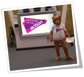 The PCA Aware Bear collecting at King's Cross Station on World Pancreatic Cancer Day
