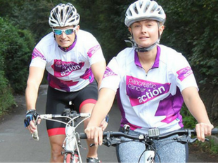 A photo of two cyclists taking part in Pedal 4 Cancer to fundraise for Pancreatic Cancer Action this New Year.