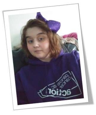 A picture of Emma Hardy in a Pancreatic Cancer Action jumper