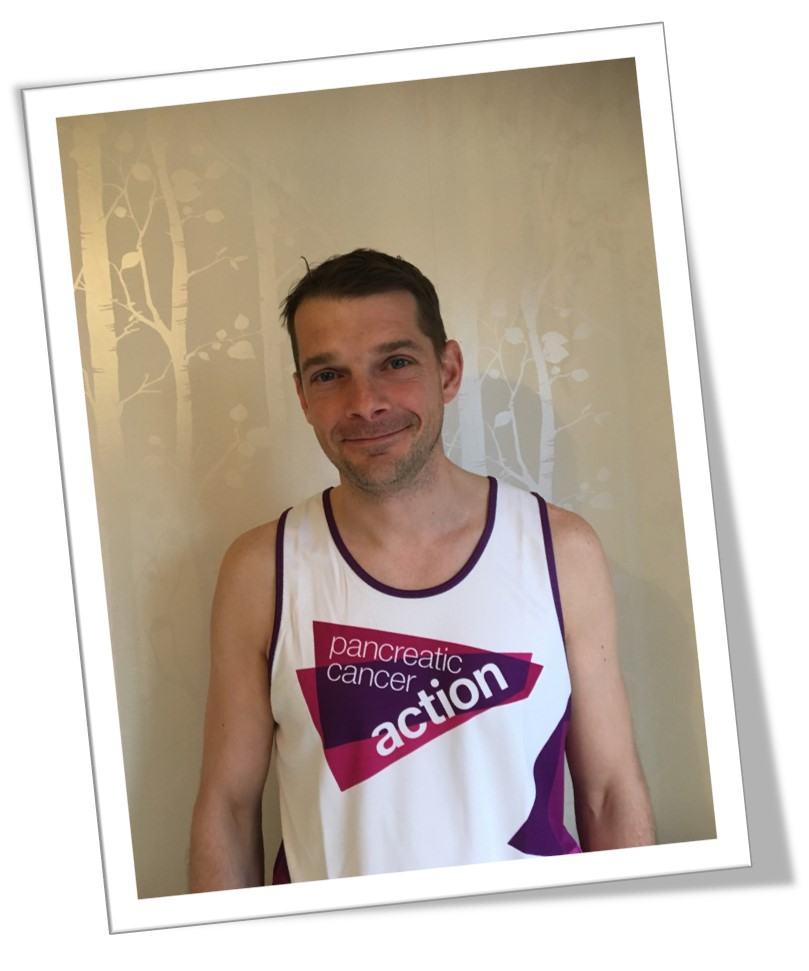 A picture of Stephen Dell wearing a Pancreatic Cancer Action running vest