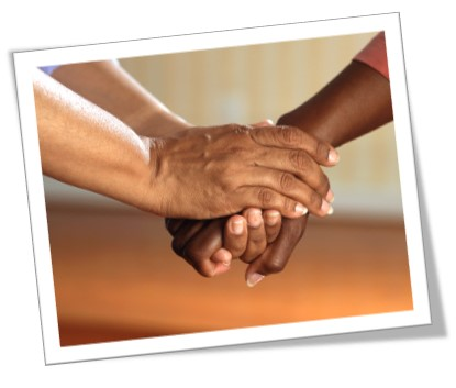 A picture of someone holding somebody else's hand for Share Your Story month