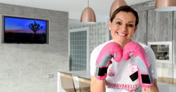 Soraya smiling wearing pink boxing gloves