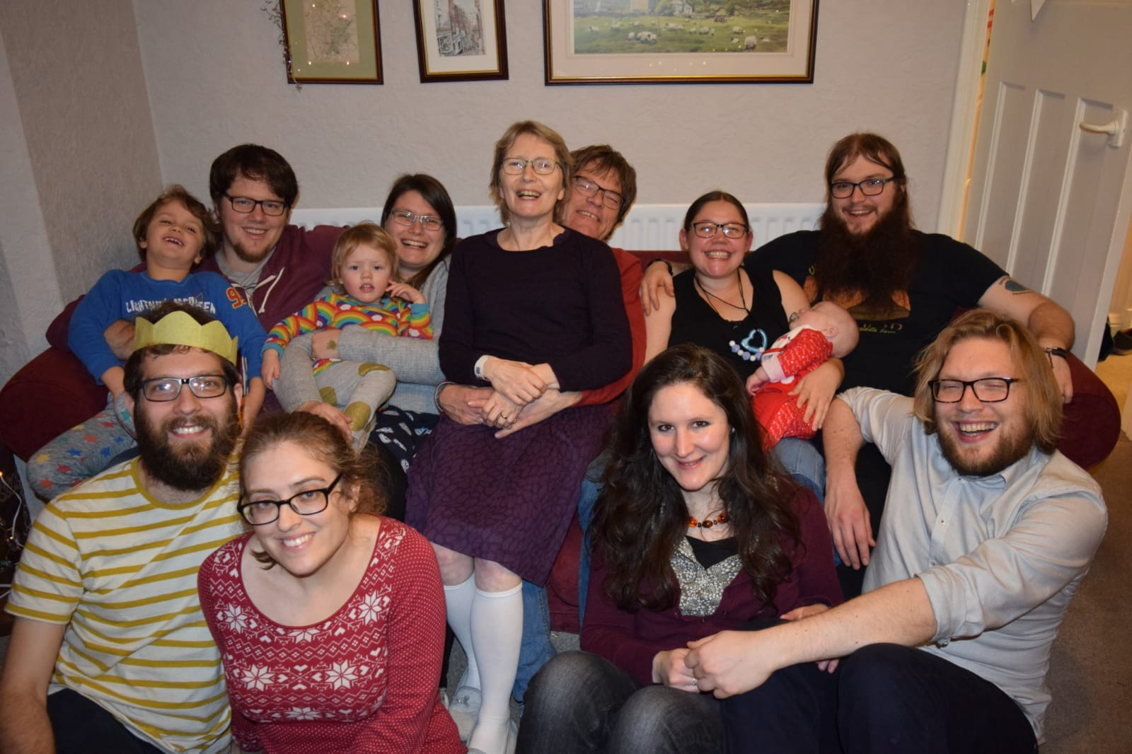 Thom with his Mum and family celebrating Christmas