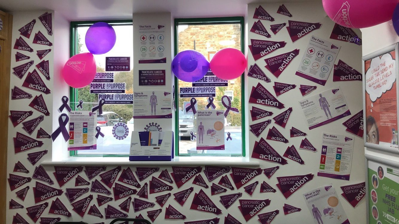 Purple walls in a pharmacy Pancreatic Cancer Action's Turn it Purple campaign