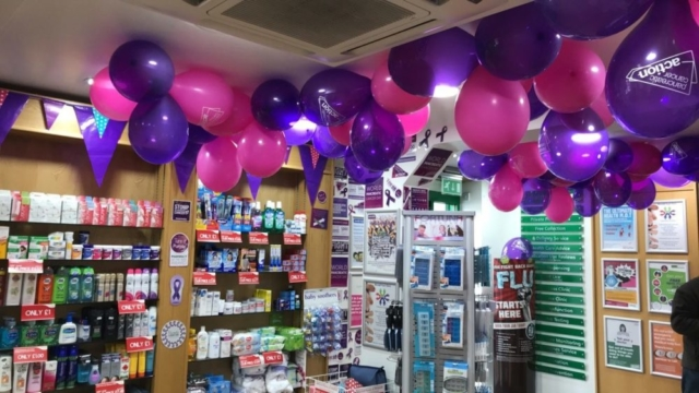 Purple Pancreatic Cancer Action balloons and decorations in Knights Oakwood Pharmacy for Pancreatic Cancer Action's Turn it Purple campaign