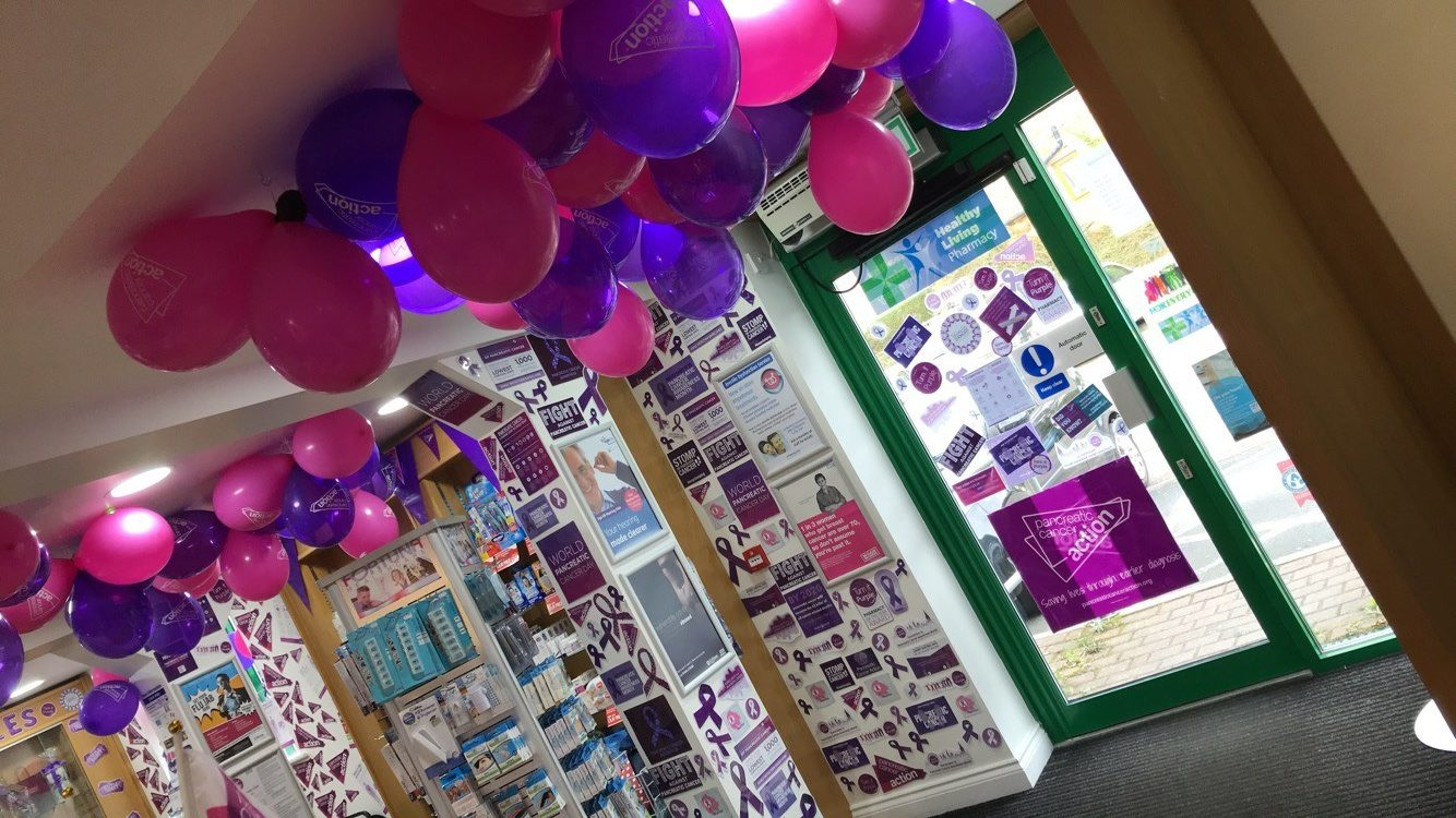 urple Pancreatic Cancer Action balloons and decorations in Knights Oakwood Pharmacy for Pancreatic Cancer Action's Turn it Purple campaign