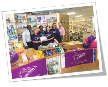 Bedminster Pharmacy receiving their Turn it Purple award